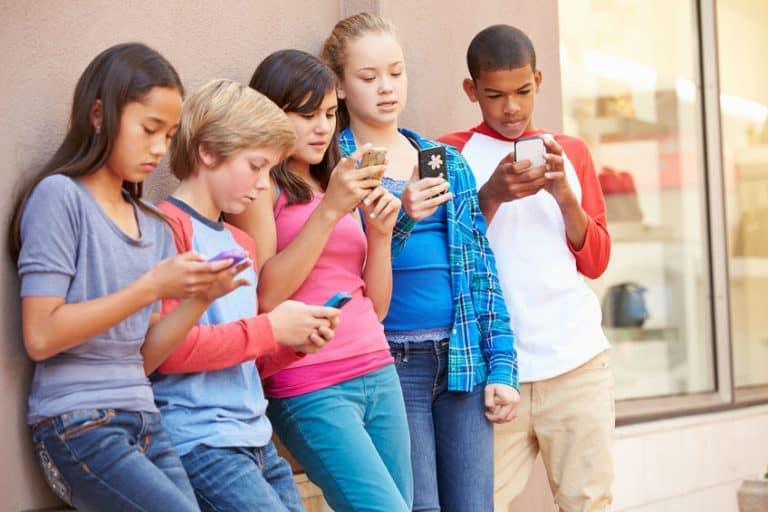 group of kids using phones
